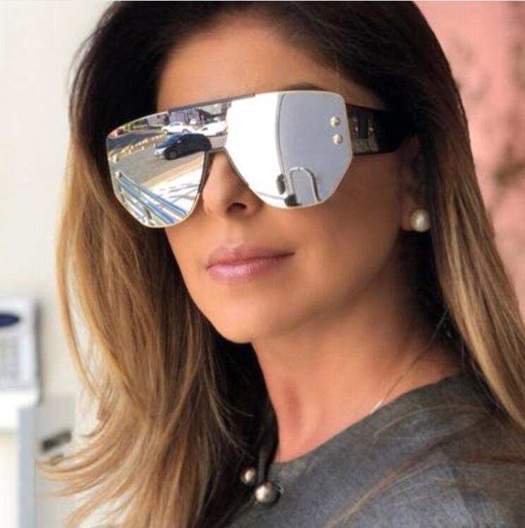 Солнцезащитные очки с широкими сторонами в моде